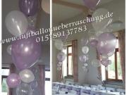 Tischdekoration mit Ballons verschiedener Größe