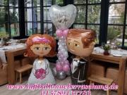 Hochzeitsdekoration, Hochzeitssäule mit Brautpaar